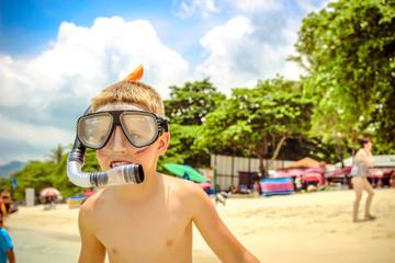 little boy on the beach in snorkeling mask. Koh Samui Thailand