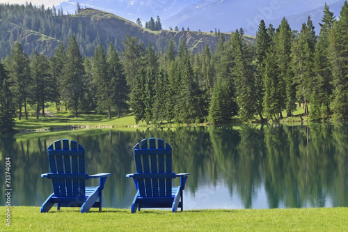 Foto op Canvas Canada Adirondack chirs overlooking a lake in Canada
