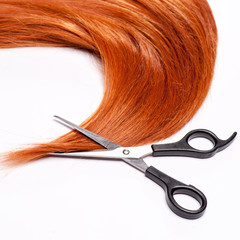 Shiny red hair and hair cutting shears
