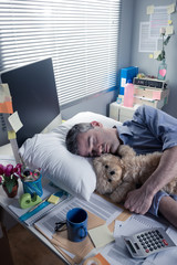 Funny office worker sleeping in the office overnight