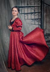Beautiful woman in fluttering medieval dress