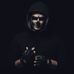 Portrait of man with Halloween skull makeup