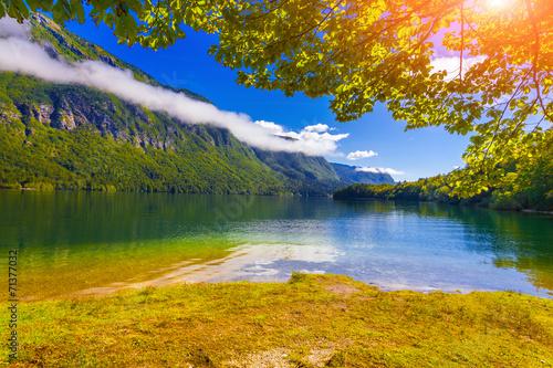 Colorful summer morning on the Bohinj lake in Triglav national p