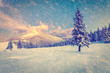 Beautiful winter sunrise in the mountains. Retro style.