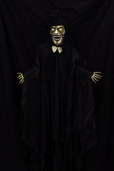 Scary skeleton puppet with bow tie and hat, horror show