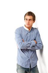 Portrait of handsome casual man standing with arms folded,