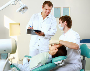 Young woman with dentist in a dental surgery. Healthcare,