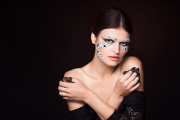 Sensual woman with creative face art
