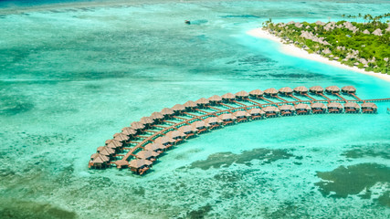 aerial view of irufushi island, bungalows and coast, maldives