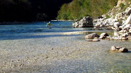 Kayaking in river rapids