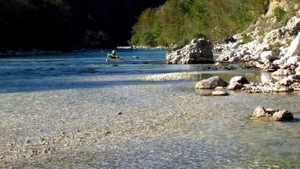 Kayaking in river rapids