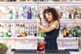 Young barmaid inside Be Towers bar in Budrio, Bologna, Italy. Th - Fine Art prints