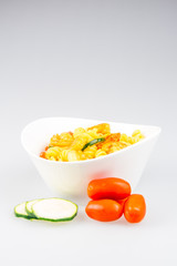 fusilli with curry, shrimps, zucchini and cherry tomato