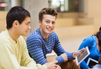 group of students with tablet pc and coffee cup