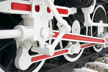Wheel of train with white and red mechanism
