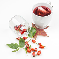 rose hips on white background with rose hip tea