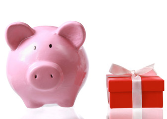 Piggy bank style money box and gift isolated on a white