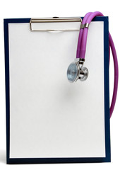 A violet stethoscope lying near white laptop computer