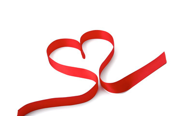 A red ribbon shaping heart , isolated on white background.
