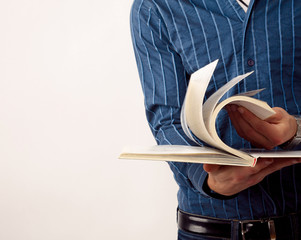 Unknown young man with book isolated.