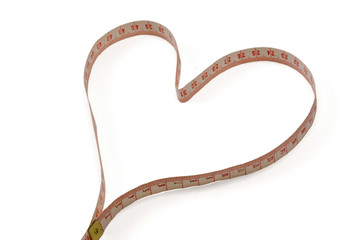 A measuring tape shaping a heart.