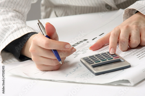 Business woman working with tax documents. - 71382415