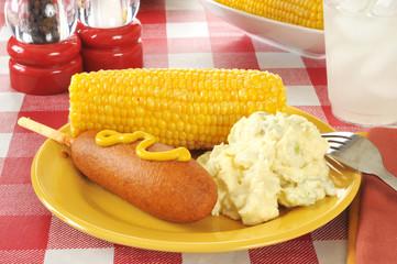 Corn dog on a picnic table