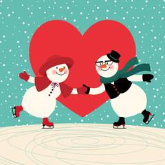Two lovers snowmen having fun skating