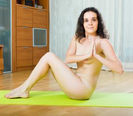 Nude woman having pilates class