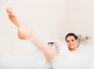 Girl in foam at bathtub