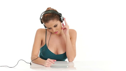 Young beautiful sexy woman listening music in large stereo headp