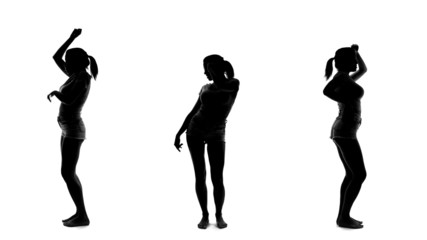 Silhouette of beautiful sexy woman dancing and listening music,