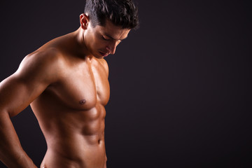 Man with beautiful torso on black background
