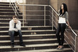 Young fashion couple in conflict on the steps