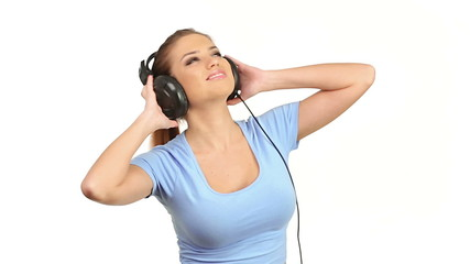 Young beautiful woman listening music in large stereo headphones