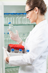 Lab assistant holding box