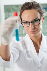 Lab technician analyzing result of experiment