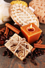 Soap with coffee beans and spices, sponge and massage brush