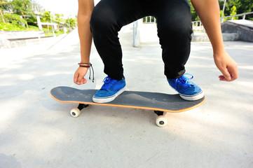woman legs skateboarding at skatepark