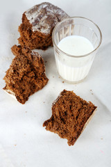 Rye bread and glass of milk on fabric background