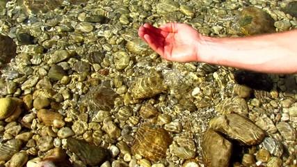 Purity - human hand taking pure water