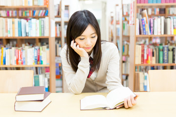 young asian student studying in the library