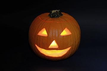 Halloween pumpkin carved into jack-o-lantern