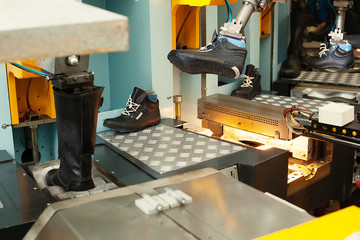 Manufacture of leather footwear in workshop