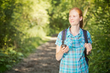 Hiker Navigating Her Way on a Trail