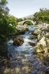 Старинный мост через горную реку.