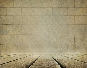 Old brick wall and wooden floor background