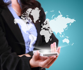 business woman holding mobile phone with world map