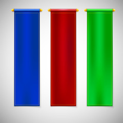 Vertical colored flags with emblems.
