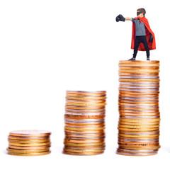 Superhero atop a pile of coins.